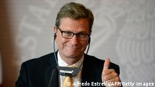 Germany Foreign Minister Guido Westerwelle gives his thumb up during a press conference at the Foreign Office in Mexico City on June 1, 2013. Westerwelle arrived in Mexico for a few-hours visit. AFP PHOTO/Alfredo Estrella (Photo credit should read ALFREDO ESTRELLA/AFP/Getty Images)