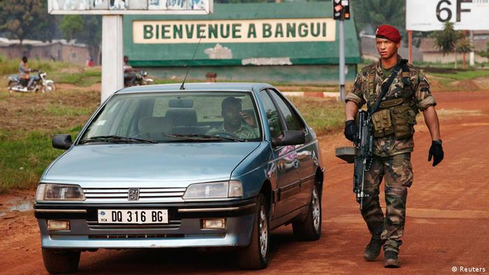 A French soldier inspects a car at a checkpoint at the Mpoko airport in Bangui November 23, 2013. REUTERS/Joe Penney