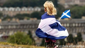 epa03876920 A child wrapped in a Scottish flag at a 'Rally for Scottish Independence' in Edinburgh, Scotland, Britain, 21 September 2013. A referendum will take place within Scotland on 18 September 2014 to ask voters whether it should be an independent country outwith the United Kingdom. EPA/GRAHAM STUART