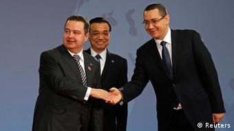 Serbia's Prime Minister Ivica Dacic (L) is welcomed by China's Premier Li Keqiang and Romanian Prime Minister Victor Ponta (R) at the meeting of heads of government from Central and Eastern European countries and China in the lobby of the Parliament building in Bucharest November 26, 2013. REUTERS/Bogdan Cristel (ROMANIA - Tags: POLITICS)
