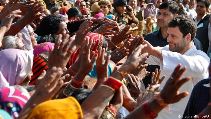 Congress party leader Rahul Gandhi, right, interacts with his supporters during a public rally organized ahead of elections in the western Indian state of Rajasthan, in Pushkar, India, Monday, Nov. 25, 2013. (Photo: AP/Deepak Sharma)