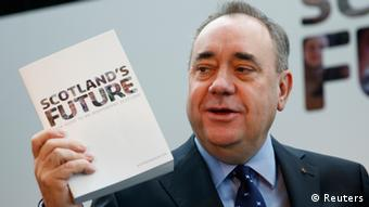Alex Salmond holding up the white paper for Scottish Independence