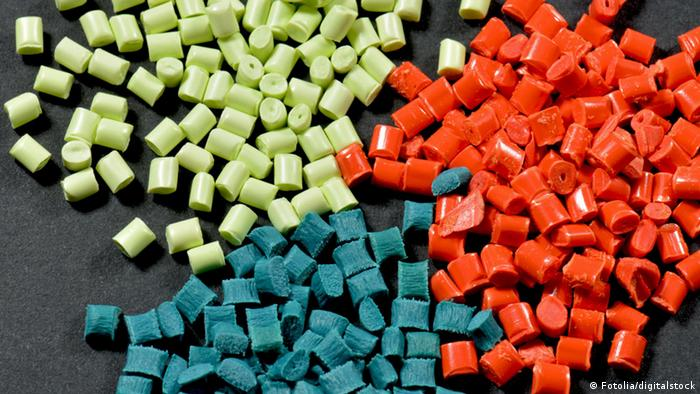 Colored plastic pellets in green, blue and orange