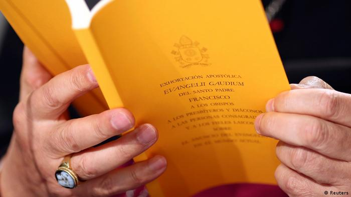 The document of the Evangelii Gaudium (The Joy of the Gospel) from Pope Francis is seen as Bishop Carlo Maria Celli reads during a presentation in Vatican November 26, 2013. REUTERS/Alessandro Bianchi (VATICAN - Tags: RELIGION)