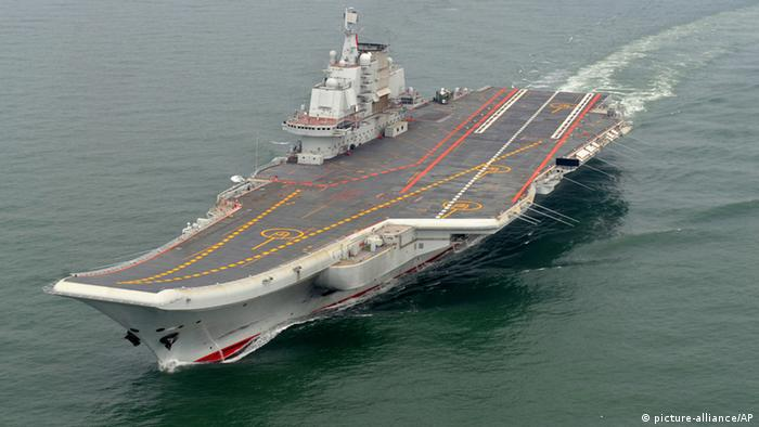 FILE - This May 2012 file photo provided by China's Xinhua News Agency shows the Chinese aircraft carrier Liaoning cruising for a test on the sea. A congressional advisory panel sounded a warning Wednesday about China's military buildup, predicting Beijing could possess the largest fleet of modern submarine and combatant ships in the western Pacific by 2020. The U.S.-China Economic and Security Review Commission said China's military modernization is altering the balance of power in the Asia-Pacific region and challenging decades of U.S. pre-eminence. (AP Photo/Xinhua, Li Tang, File) NO SALES