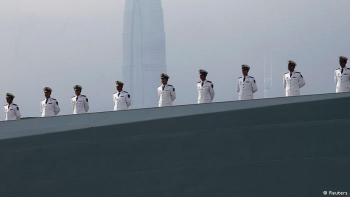 Chinese People's Liberation Army (PLA) Navy personnel stand on the deck of the Chinese naval guided missile destroyer Haikou (171) during a welcome ceremony as it docks at the Ngong Shuen Chau Naval Base in Hong Kong in this April 30, 2012 file photo. Picture taken April 30, 2012. To match Special Report CHINA-NAVY/ REUTERS/Tyrone Siu/Files (CHINA - Tags: POLITICS MILITARY CITYSCAPE)
