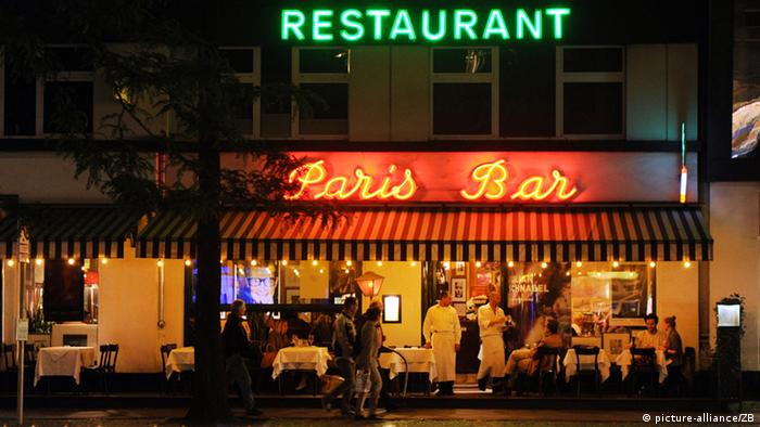 The Paris Bar on Kantstrasse in Berlin at night, it's green and red neon lights shine against the darkness Photo: Jens Kalaene dpa/lbn