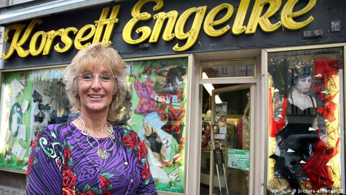 Antje Fröhlich, owner, stands in front of Korsett Engelke lingerie shop, one of many lively business along Kant Street Photo: Stephanie Pilick dpa/lbn