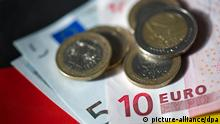 Symbolbild Euroscheine Deutschland Fahne