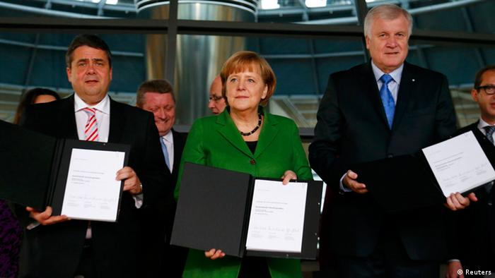 Party leaders German Chancellor Angela Merkel (C) of the Christian Democratic Union (CDU), Horst Seehofer (R) of the Christian Social Union (CSU) and Sigmar Gabriel of the Social Democratic Party (SPD) sign a preliminary agreement, which has still to be approved by the members of the SPD, in the Bundestag in Berlin, November 27, 2013. Chancellor Angela Merkel's conservatives and the centre-left Social Democrats (SPD) clinched a coalition deal early on Wednesday that puts Germany on track to have a new government in place by Christmas. The agreement was struck roughly two months after Merkel was the clear winner in national elections but fell short of a parliamentary majority, forcing her into talks with the arch-rival SPD, with whom she ruled in an awkward grand coalition during her first term as Chancellor from 2005-2009. REUTERS/Tobias Schwarz (GERMANY - Tags: POLITICS)