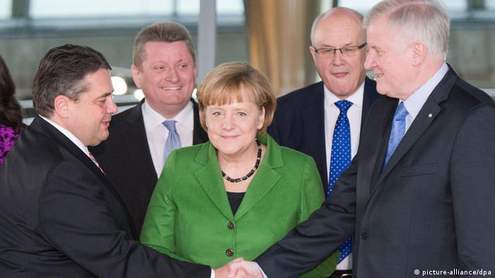 SPD leader Sigmar Gabriel, left, CDU leader Angela Merkel and CSU leader Horst Seehofer sign the agreement Photo: Maurizio Gambarini/dpa