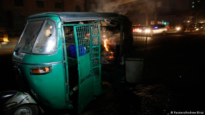 An auto rickshaw burns after being set on fire along a street in Dhaka November 25, 2013. Supporters of Bangladesh Nationalist Party (BNP) led opposition parties blast crude bombs, vandalized and set fire on vehicles after the announcement of 10th paliamentary election schedule on Monday, local media reported. Bangladesh will hold a general election on Jan. 5, the Election Commission said on Monday, in an announcement likely to anger the opposition which is demanding a neutral caretaker government to oversee the polls. REUTERS/Andrew Biraj (BANGLADESH - Tags: POLITICS CIVIL UNREST)