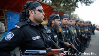 Members of Rapid Action Battalion (RAB) stand guard during a nationwide protest in Dhaka November 26, 2013 (Photo: REUTERS/Andrew Biraj)