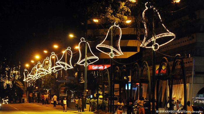 Christmas lights shaped like bells line the street