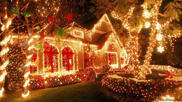 A residential house covered in Christmas lights