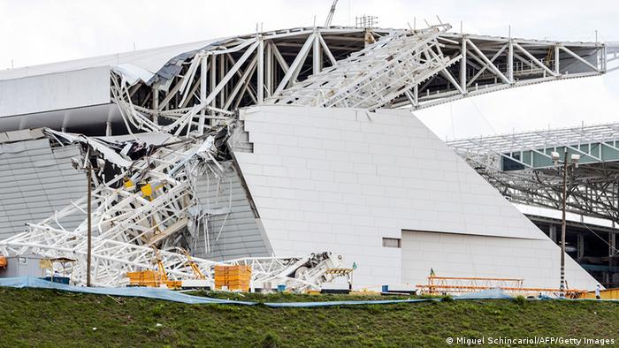 View of damages at the Arena de Sao Paulo --Itaquerao do Corinthians-- stadium, still under construction, after a crane fell across part of the metallic structure, on November 27, 2013 in Sao Paulo. Two people died and another was injured following the accident on the stadium that will host the opening match of Brazil 2014 FIFA World Cup. AFP PHOTO / Miguel SCHINCARIOL (Photo credit should read Miguel Schincariol/AFP/Getty Images)