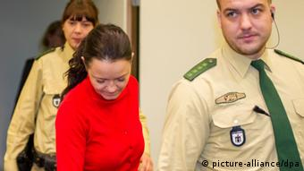 Defendant Beate Zschaepe (C) enters the courtroom at the Higher Regional Court in Munich, Germany, 27 November 2013. Today Zschaepe's cousin and mother will give testimony during the murder and terrorism trial into the National Socialist Underground. Photo: MARC MUELLER