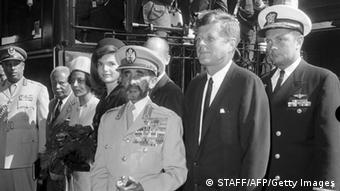 WASHINGTON, DC - OCTOBER 1: Ethiopian Emperor Haile Sellassie I (C) and his granddaughter Princess Ruth Desta are welcomed by U.S President John F. Kennedy and his wife Jackie (2d L) 1st October 1963 in Washington. After having led the revolution in 1916 against Lij Yasu he became regent and heir to the throne, westernizing the institution of his country. Settled in England after the Italian conquest of Abyssinia, he was restored in 1941 after the British liberation. In the early 1960s he helped to establish the Organization of African Unity. The disastrous famine of 1973 led to economic chaos, industrial strikes, and mutiny among the armed forces, and he was deposed 12 September 1974 in favour of the Crown Prince. He die in 1975. (Photo credit should read STAFF/AFP/Getty Images)