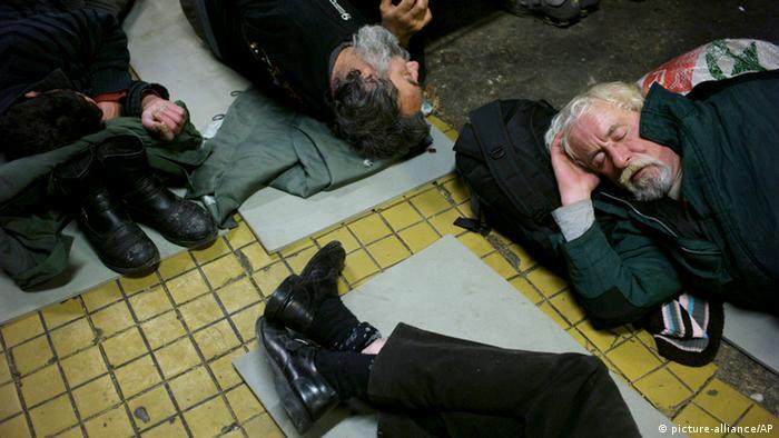 Budapest homeless men sleeping