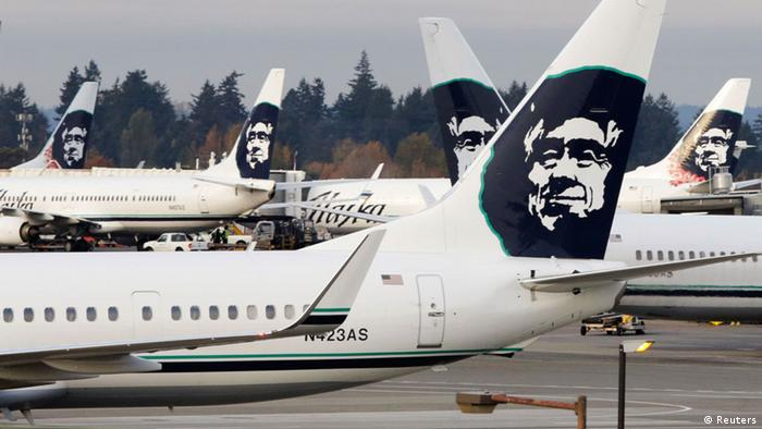 Airlines logo showing a smiling Eskimo face on tails of Alaska Airline airplanes (Reuters)