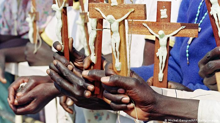Worshipers holding Christians symbols in Africa