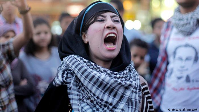 An Egyptian protester chants slogans in Talaat Harb Square in Cairo, Egypt, against the issuance of a new law regulating demonstrations, Thursday, Nov. 28, 2013. (AP Photo/Amr Nabil)
