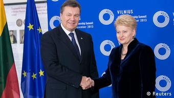 Ukraine's President Viktor Yanukovich (L) shakes hands with his Lithuanian counterpart Dalia Grybauskaite during the EU Eastern Partnership summit in Vilnius November 28, 2013. The European Union told Ukraine it was risking its economic future by rejecting a free-trade deal in favour of closer ties with Russia, hours before a likely frosty encounter on Thursday evening between EU leaders and Yanukovich. REUTERS/eu2013.lt/Handout via Reuters (LITHUANIA - Tags: POLITICS BUSINESS) ATTENTION EDITORS - THIS IMAGE WAS PROVIDED BY A THIRD PARTY. FOR EDITORIAL USE ONLY. NOT FOR SALE FOR MARKETING OR ADVERTISING CAMPAIGNS. NO SALES. NO ARCHIVES. THIS PICTURE IS DISTRIBUTED EXACTLY AS RECEIVED BY REUTERS, AS A SERVICE TO CLIENTS