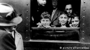 Children say goodbye to their parents at a German train station during World War II