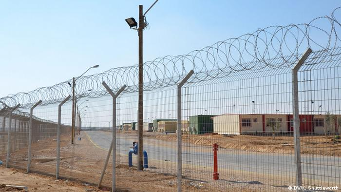 The sweeping fence outside Sadot open detention facility. Copyright: DW/ Kate Shuttleworth, DW, Israel, Nov 2013