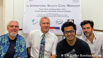 Picture No: 1 Titel: One for the album Description: The participating comic strip artists from Germany, France and India, along with the German Consul General of Kolkata Keywords: comic strip workshop, artists, Germany, France, India, German Consulate, Kolkata Who is in the picture: (from Left to Right) Yoerg Reuter of Germany, German Consul General in Kolkata Reiner Scmiedchen, Charbak Dipta of India and Ollivier Tallec of France When was it taken: 28th November 2013 Where was it taken: German Consulate, Kolkata, India Copyright: I (Sirsho Bandopadhyay) have taken the picture and give DW the right to use it!