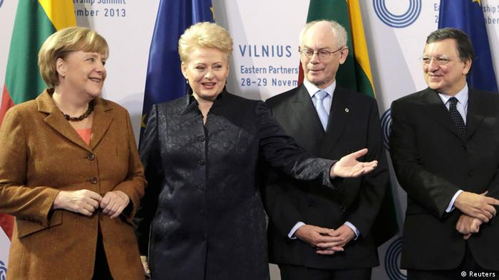 Germany's Chancellor Angela Merkel is welcomed by Lithuanian President Dalia Grybauskaite, European Council President Herman van Rompuy and European Commission President Jose Manuel Barroso (L-R) at the EU Eastern Partnership summit in Vilnius November 29, 2013. REUTERS/Ints Kalnins (LITHUANIA - Tags: POLITICS BUSINESS)
