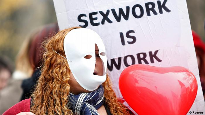 A sex worker activist attends a demonstration with prostitutes against a proposal to scrap sanctions on soliciting and instead punish prostitutes' customers with fines in Paris November 29, 2013. (Photo: REUTERS/Charles Platiau)