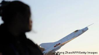 A woman walks near Chinese aircraft on display during a visit to a museum in Beijing on November 29, 2013. China sent fighter jets and an early warning aircraft into its newly declared air defence zone, state media said on November 29, as Japan and South Korea stated they had defied the zone with military overflights. AFP PHOTO / WANG ZHAO (Photo credit should read WANG ZHAO/AFP/Getty Images)