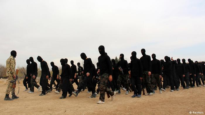 Islamist fighters march during their graduation ceremony at a camp (photo: REUTERS/Diaa Al-Din)