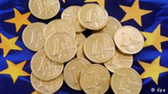 Euro coins on an EU flag