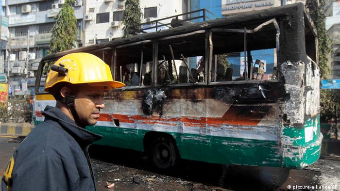 In this Thursday, Nov. 28, 2013 photo, a firefighter inspects a burnt bus after being set on fire by activists of Bangladesh¿s main opposition party during a 72-hour nationwide strike, in Dhaka, Bangladesh. General strikes shutting down transportation, businesses and industry are common tactics in South Asia to press political agendas. In the past month, about 40 people have been killed and hundreds wounded as rival political factions clashed in the streets. At least eight of the dead and 80 of the wounded suffered burns, according to Dhaka Medical College Hospital. Many of the victims were just trying to earn a living in one of the most impoverished countries in the world. (AP Photo/A.M. Ahad)