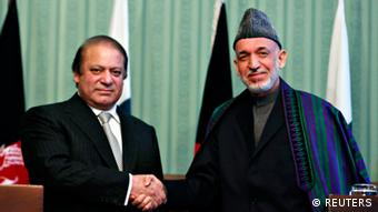 Afghan President Hamid Karzai (R) shakes hands with Pakistan's Prime Minister Nawaz Sharif at a joint news conference in Kabul November 30, 2013 (Photo: REUTERS/Mohammad Ismail)