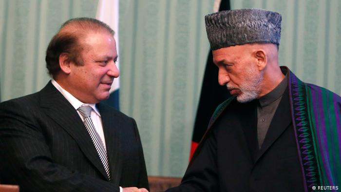 Afghan President Hamid Karzai (R) shakes hands with Pakistani Prime Minister Nawaz Sharif at a joint news conference in Kabul November 30, 2013 (Photo: REUTERS/Mohammad)