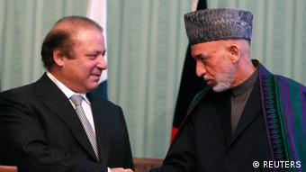 Afghan President Hamid Karzai (R) shakes hands with Pakistani Prime Minister Nawaz Sharif at a joint news conference in Kabul November 30, 2013 (Photo: REUTERS/Mohammad Ismail)
