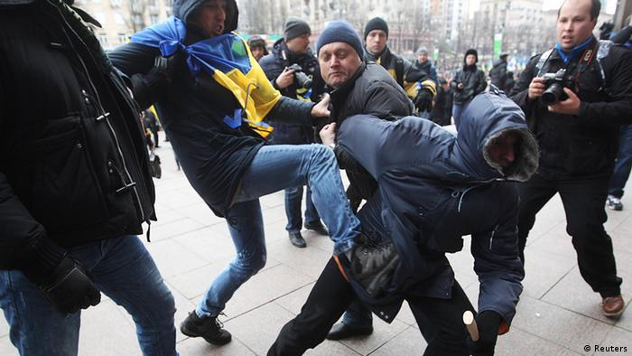 Rally participants attack an unidentified man suspected to be a provocateur (Photo: REUTERS/Valentyn Ogirenko)