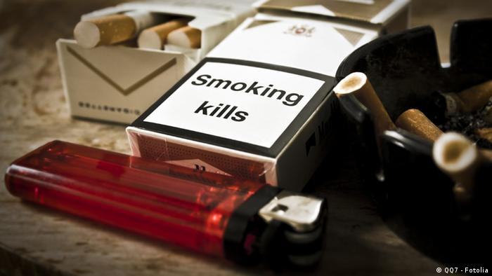 Still life of cigarette boxes, lighter and an ashtray full of fags (Copyright Fotolia)