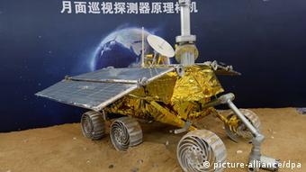 FILES - A model of the moon rover Yutu (Jade Rabbit) which will be carried by Change-3 satellite on its lunar probe mission in December displayed during the 15th China International Industry Fair in Shanghai, China, 5 November 2013. China will launch a lunar probe, Change-3 in early December, the State Administration of Science, Technology and Industry for National Defense announced Tuesday (26 November 2013) morning in Beijing. The Change-3 satellite and its carrier, the Long March-3B, are now in Xichang city of Sichuan province. The probe will be blasted into space within the first 10 days of December, Wu Zhijian, spokesman for the agency, told a press conference. The lunar probe will conduct a soft landing on the moons surface. Change-3 encompasses a lander and a special moon rover called Yutu (Jade Rabbit) for detailed exploration and collection of lunar soil and stone samples. The lunar probe will land on the moon in mid-December if everything is successful, said Wu. The Change-3 mission is the second phase of Chinas lunar program, which includes orbiting, landing and returning to Earth. It follows the success of the Change-1 and Change-2 missions in 2007 and 2010. The mission is part of the second stage of Chinas three-stage, unmanned lunar exploration, which includes orbiting, landing, analyzing and returning with lunar soil and stone samples. The three stages are expected to be completed by 2020. (zu dpa China will mit «Jadehase» erstmals auf dem Mond landen vom 26.11.2013 - ACHTUNG: Nur für Tageszeitungen/keine Magazine!) +++(c) dpa - Bildfunk+++