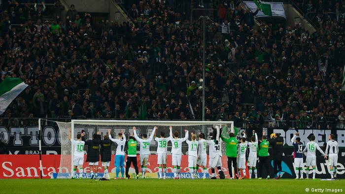 MOENCHENGLADBACH, GERMANY - DECEMBER 01: Borussia Moenchengladbach players celebrate after the Bundesliga match between Borussia Moenchengladbach and SC Freiburg at Borussia-Park on December 1, 2013 in Moenchengladbach, Germany. (Photo by Dennis Grombkowski/Bongarts/Getty Images)