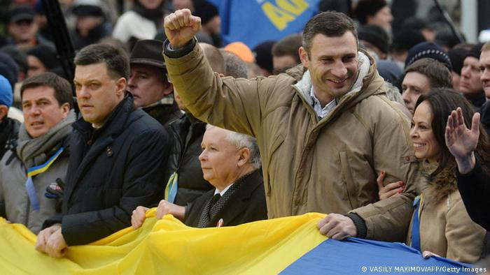 Polish former prime minister and opposition leader Jaroslaw Kaczynski (3rdR), leaders of Ukrainian opposition Vitaly Klitschko (2ndR) and Oleg Tyagnybok (2ndL) attend a mass rally of the opposition packs Independence Square in Kiev on December 1, 2013. Some 100,000 Ukrainians chanting Revolution! swarmed a central Kiev square Sunday in a mass call for early elections meant to punish President Viktor Yanukovych for rejecting a historic EU pact. AFP PHOTO/ VASILY MAXIMOV (Photo credit should read VASILY MAXIMOV/AFP/Getty Images)