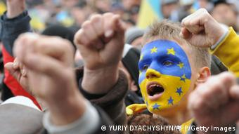 Ukrainian protesters shout slogans as thousands gather for a pro-EU opposition rally in the center of western Ukrainian city of Lviv on December 1, 2013. The economically struggling nation of 46 million was thrown into its deepest crisis since the 2004 pro-democracy Orange Revolution when Yanukovych snubbed EU leaders at a summit on Friday and opted to keep Ukraine aligned with its former master Russia. AFP PHOTO/ YURIY DYACHYSHYN (Photo credit should read YURIY DYACHYSHYN/AFP/Getty Images)