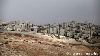 A view of the Israeli separation wall of Shuafat refugee camp (Photo: Abir Sultan)