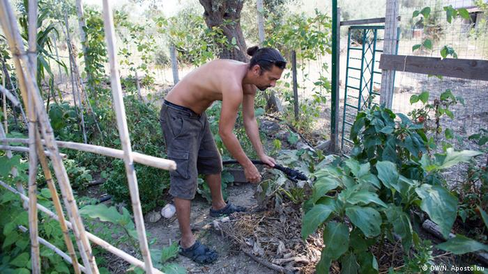 Apostolis Sianos works in the garden at Free&Real