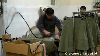Italien - Textilfabrik Prato, Chinesische Arbeiter