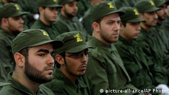 Hezbollah fighters attend a rally. (Photo: AP Photo/Bilal Hussein, File)