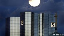 A rising full moon is seen over the twin towers of Germany's Deutsche Bank headquarters in Frankfurt January 28, 2002. A group of leading European and American banks will be fined a record 1.7 billion euros ($2.3 billion) by the European Commission for the rigging of interest-rate benchmarks, a source familiar with the matter told Reuters on December 4, 2013. The banks to be fined are Citigroup, Deutsche Bank, Royal Bank of Scotland, JPMorgan, Barclays and Societe Generale, sources have said. REUTERS/Kai Pfaffenbach (GERMANY - Tags: BUSINESS)